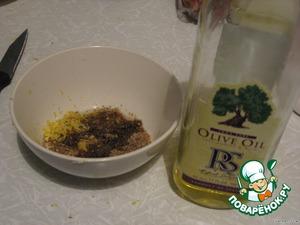 Смешиваем специи для рыбы с оливковым маслом, солью и цедрой половины лимона