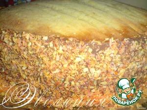 Бока обмазываем шоколадным кремом (или какой у вас останется) и обсыпаем кокосовой стружкой.