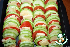 Slice the zucchini and tomato slices  Arrange them in alternating rows in a high-temperature form  Cut thin cheese slices  Lay it between the tomatoes and zucchini