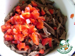 Boiled heart and the pepper cut into strips.