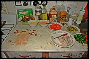 Further, when all the ingredients are ready, spread pita bread with sauce the place where you will put the stuffing.