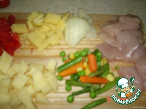 Cut chicken fillet, potato, tomato, cheese, onion - diced.  Cook frozen vegetables (any which is).