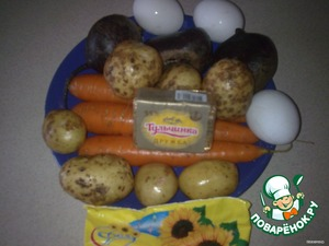 The products required.  Beets, carrots, potatoes and eggs pre-boiled, cooled.