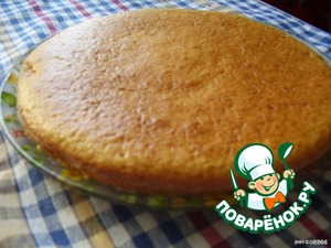 I check the readiness with a toothpick - it should be dry.  The finished cake out onto a dish, allow to cool. The cooled cake cut into two pieces (there should be two round cake).