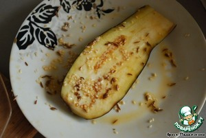 Soak the eggplant in egg, roll in caraway seeds and sesame seeds