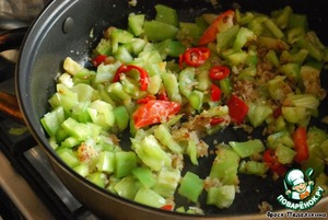 Over moderate heat, heat the oil and saute the onions.  Add a pinch of sugar, all the peppers and fry for a few minutes.