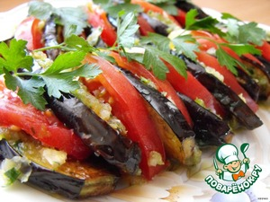 Roll roasted eggplant in a spicy mixture.  Place them on a dish, alternating with tomato slices.