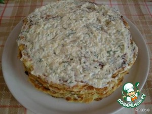 Pancakes grease with the cream and send the cake for impregnation in the cold.