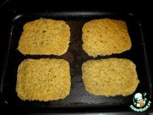 Разогреть духовку при температуре 200 гр., поставить противень и печь, пока сыр не расплавится и не станет кружевным (примерно 3 мин).