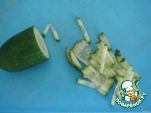 Cut cucumber in thin strips,like matchsticks,about half of a medium cucumber and also a jar of it.