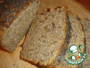 Готовый хлеб, не вынимая из формы, слегка смажьте сверху сливочным маслом. Я просто разложила сверху тонюсенькие кусочки масла. Накройте полотенцем и дайте ему постоять.   Хлеб получается с хрустящей корочкой, мягкий внутри и с множеством семян. Очень интересный вкус. Но все же я рекомендую не экспериментировать с мукой, а приобрести цельнозерновую, я в следующий раз так и сделаю.   Моему супругу хлебушек очень понравился, он ел его с удовольствием, отметив при этом, что такого хлеба в магазине точно не найти!      Приятного аппетита!