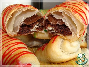 We have in store sell something like this- croissants with chocolate filling.  Children eat them willingly. Try it!