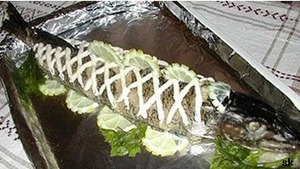 Pike is ready remove from the oven and let cool without removing foil.  To serve cold, put on a large platter and garnish with lemon wedges.  Stuffed pike apply sauce with horseradish.   (Tip - the stuffed pike often boiled in water or steamed, but if there is no pan the right size, you can bake the pike in the foil.)