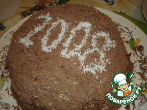 Украсить торт шоколадом. Надпись сделать кокосовой стружкой.