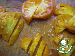 - cut into the plate of yellow tomatoes