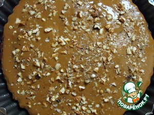Pour this mixture hot cake and sprinkle with remaining walnuts.