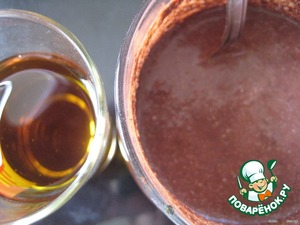 Add cocoa and vegetable oil and mix well until smooth; set aside aside.