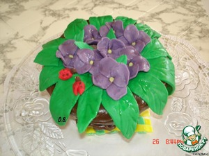 Put the prepared flowers and leaves, and the cake is ready.