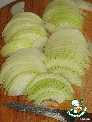Onion cut into half rings,