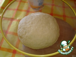 Make a ball of dough, place in a greased bowl and put in warm place to raise dough in half, to 1-1.5 hours.
