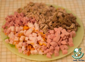 Boiled beef and pork, salmon, ham and sausages cut into small cubes.