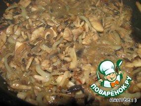 Add the mushrooms. A little salt, pepper, curry added.