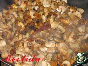 Fry in olive (or vegetable) oil chopped onion and chopped mushrooms until light brown colour