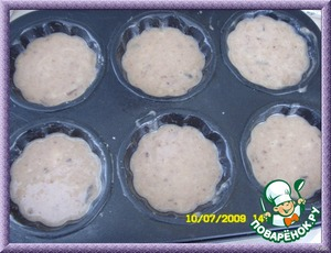 pour the mixture into the muffin tins, filling them 3/4 full, and send in a pre-heated 175 degree oven.  Bake for 25-30 minutes or until done: toothpick comes out of center dry, but with moist crumbs.