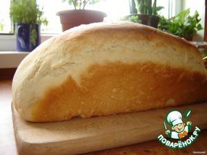 Дальше приминаем тесто, месим его минутки 2, делим на две части и формируем хлеб или выкладываем в формы.    Через 30 мин., когда тесто подойдет в формах, ставим в разогретую до 180 град. духовку и печем 30 мин.    Готовый хлеб сразу извлекаем из форм и охлаждаем на решетке.