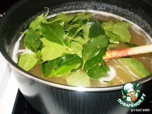 Cherry leaves wash and drop into boiling syrup
