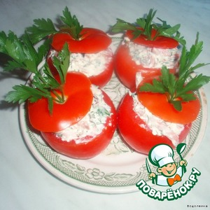 Now fill our tomatoes-cups with a stuffing of tomato on top and cover caps. Decorate with greens.  Bon appetit!