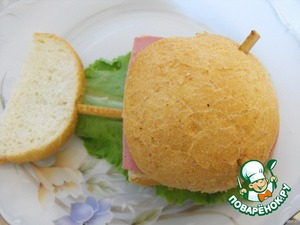 """Cover with top buns.  Insert two pieces of straw for fastening """"eyes""""."""
