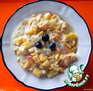 Added a couple of tablespoons of wonderful liquid honey and corn flakes.  A little cinnamon. Low-fat yogurt. Gently stirred.  Ready! Before serving put in the fridge to soak!  Health for children and adults!