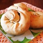 Мигнолата с луком, маслинами и колбасками