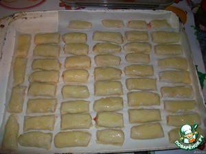 On a baking sheet rolling out the parchment and put the rolls. Grease them with egg yolk and bake it in the oven for about 30 minutes.  I got 48 pieces.