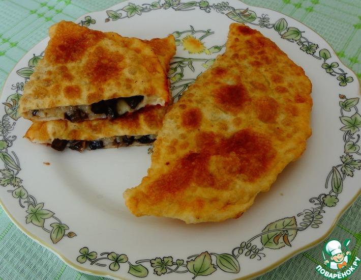 Рецепт: Жареные пирожки с рисом и грибами