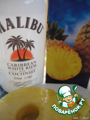 Grind the pineapple into small pieces;   liqueur mixed with pineapple juice.