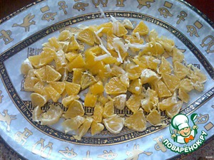 In a beautiful large platter stacked, diced, orange.
