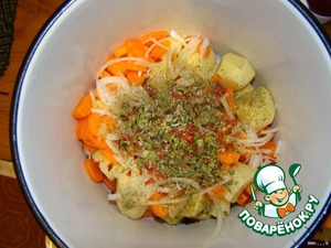 Add roughly chopped carrots, other half of onion (also roughly chopped), paprika, dried herbs, olive oil, salt. Stir it carefully.