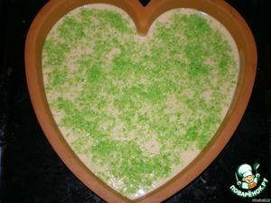 Выливаем наше тесто в форму и сверху посыпаем кокосовой стружкой (у меня была зелёного цвета).Ставим в разогретую до 180*С духовку.Готовность проверяем спичкой.