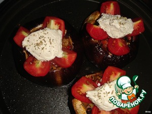At the top in the middle, add 1 tablespoon of feta and sprinkle with oregano.  Put in the oven high for 5 minutes so the tomatoes warm up, but not drip, and feta slightly melted.