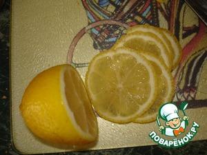 Thinly slice the lemon.