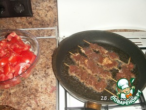 Fry until done, Then sprinkle with chopped fresh herbs, preferably Basil and onion.