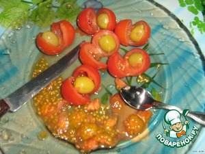 Tomatoes, cut not to end, remove the pulp,stuffed with an olive.