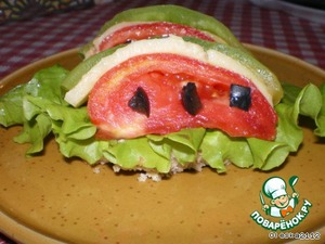"Arrange on each sandwich on top of the salad for 2 ""watermelon slice""."