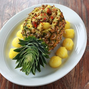 Festive pineapple with rice, chicken and nuts