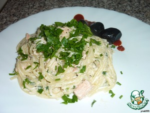 Pasta with cream sauce and red fish