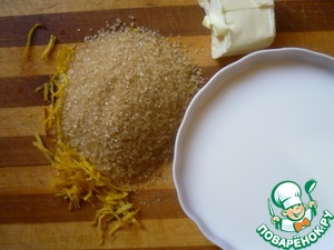 In the bowl multivarki fall asleep rice, sugar, zest, add the butter and pour in the milk