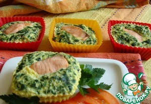 Fish baked with spinach in an omelet