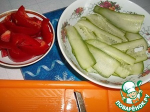 Cucumber slice or grate thin petals, red pepper cubes.